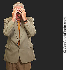 Senior Business Man In Tension Isolated On Black Background