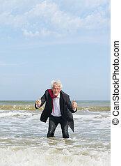 Senior business man in water