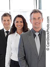 Senior business man leading a group