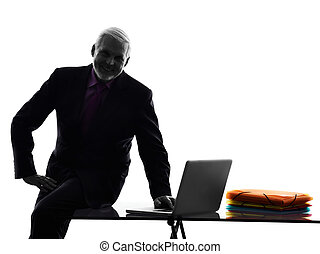 senior business man silhouette computing