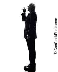 senior business man smoking electronic e-cigarette silhouette