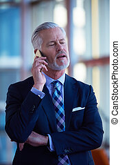 senior business man talk on mobile phone