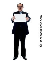 Senior business professional holding blank billboard