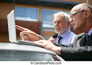 Senior business team visiting client