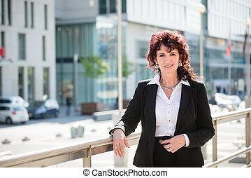 Senior business woman in street