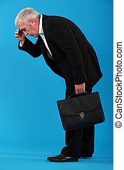 Senior businessman carrying briefcase