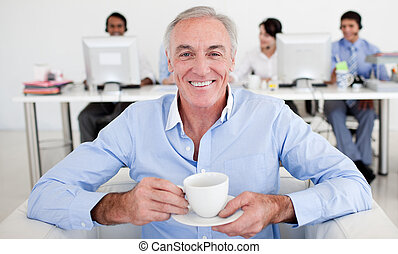 Senior businessman drinking a coffee