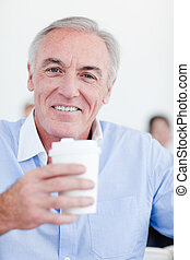 Senior businessman drinking a tea