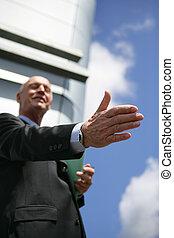 senior businessman giving a hand for a handshake