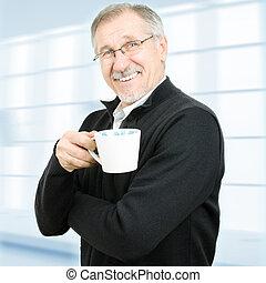 Senior businessman having a break