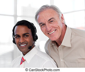 Senior businessman helping his colleague
