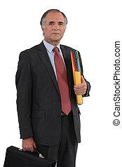 Senior businessman holding a folder