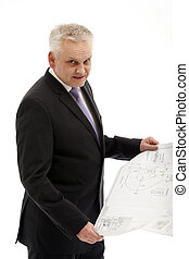 senior businessman in a suit with a plan in his hands.