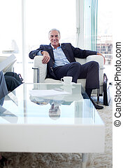 Senior businessman in a waiting relaxing
