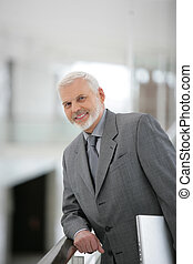 senior businessman in an elegant suit