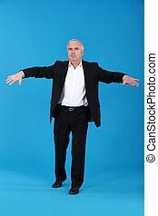 Senior businessman keeping his balance