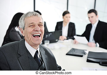 Senior businessman laughing at office meeting