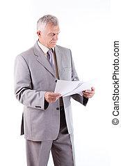 Senior Businessman looking at documents