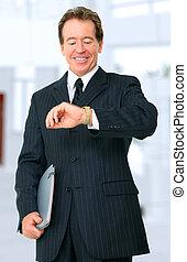 Senior Businessman Looking At His Watch