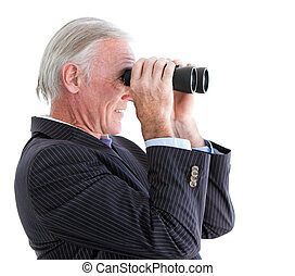 Senior businessman looking through binoculars standing