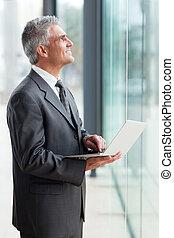 senior businessman looking up