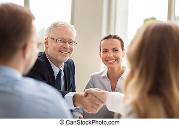 senior businessman making handshake at office