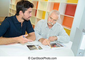 senior businessman offering proposal to young man