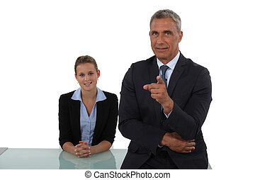 Senior businessman pointing at camera