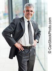 senior businessman portrait in offce