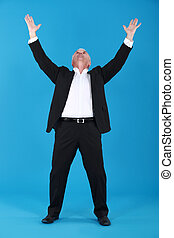 senior businessman raising his hands