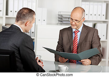 Senior businessman read the application in the office