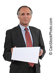 Senior businessman reading calendar