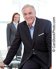 Senior businessman sitting on a conference table