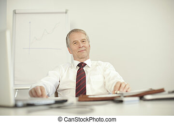 senior businessman sitting relax at his desk