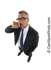 Senior businessman smoking cigar