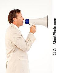 Senior businessman speaking through a megaphone