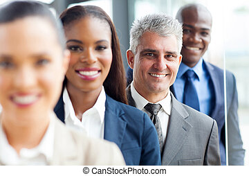 senior businessman standing in a row