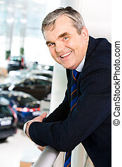 Senior businessman - Photo of happy man leaning against...
