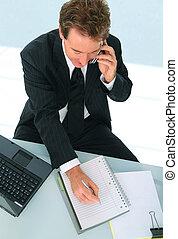 Senior Businessman Taking A Note