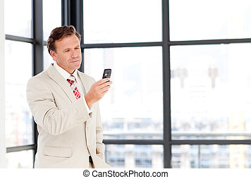 Senior businessman texting with copy-space