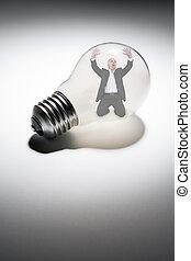 Senior businessman trapped in light-bulb