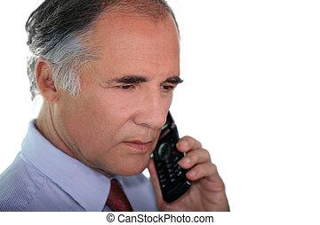 Senior businessman using a cellphone