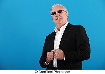 senior businessman wearing sunglasses