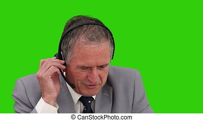 Senior businessman with an headset
