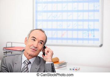 Senior businessman with cellphone