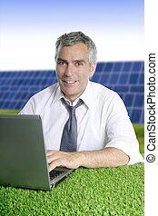 senior businessman work green grass solar plates