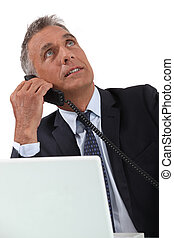 Senior businessman working at desk