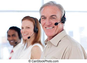 Senior businessman working in a call center