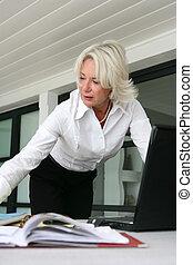 Senior businesswoman at her desk