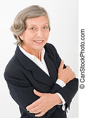 Senior businesswoman crossed arms portrait smart -...